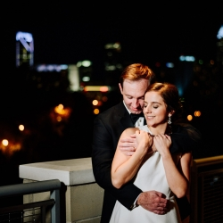 Rob and Kirsten capture a bride and groom during their evening wedding at Vivace with a stunning Charlotte skyline in the background