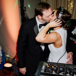 Bride and groom have fun playing DJ with the help of Z Brothers Entertainment during their fall wedding coordinated by Magnificent Moments Weddings