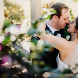 Rob and Kristen Photography captures a bride and groom embracing during their wedding coordinated by Magnificent Moments Weddings