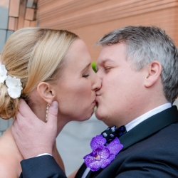 Sharon Ashley Photography captures a kiss between a bride and groom on their wedding day in Uptown Charlotte