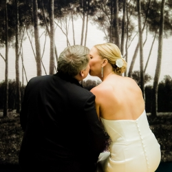 Bride and groom pose among the art of the The Bechtler during their fall wedding