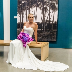Bride poses for Sharon Ashley Photography and shows of her stunning bouquet created by Carolyn Shepard