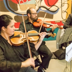 Sharon Ashley Photography captures the details of live music that played during a fall wedding ceremony at The Bechtler Museum