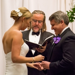 Sharon Ashley Photography capture a bride and groom as they exchange vows during their fall wedding ceremony in Uptown Charlotte