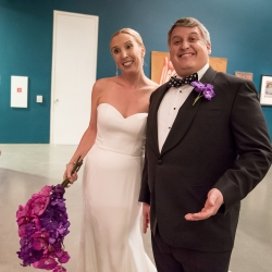 Bride and groom smile for Sharon Ashley Photography during their fall wedding at The Bechtler Museum