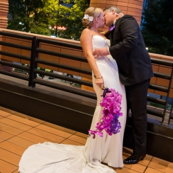 Bride and groom share a romantic kiss during their fall wedding coordinated by Magnificent Moments Weddings