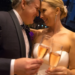 Sharon Ashley Photography captures a sweet moment between a bride and groom during their fall wedding at The Bechtler Museum
