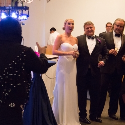 Bride is shocked by an Elvis impersonator during her fall wedding reception coordinated by Magnificent Moments Weddings