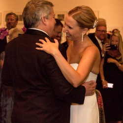 Bride and groom share a romantic first dance during their fall wedding with music provided by Ike and Martin