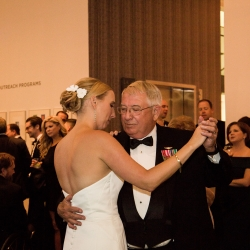 Bride dances with her father during her wedding reception planned and coordinated by Magnificent Moments Weddings