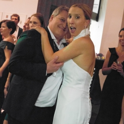Sharon Ashley Photography captures the love of a bride and groom dancing during their wedding reception at the Bechtler