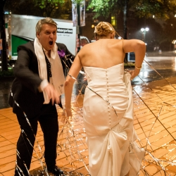 Bride and groom tangled in streamers as they leave their wedding reception at the Bechtler in Uptown Charlotte