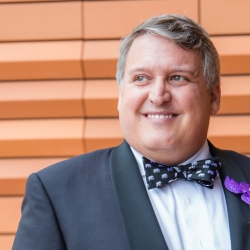 Sharon Ashley Photography captures a sweet groom as he prepares for his fall wedding at The Bechtler Museum