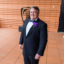 Sharon Ashley Photography captures an excited groom as he awaits his first look with is bride