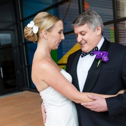 Bride and groom share a sweet moment during their wedding day coordinated by Magnificent Moments Weddings