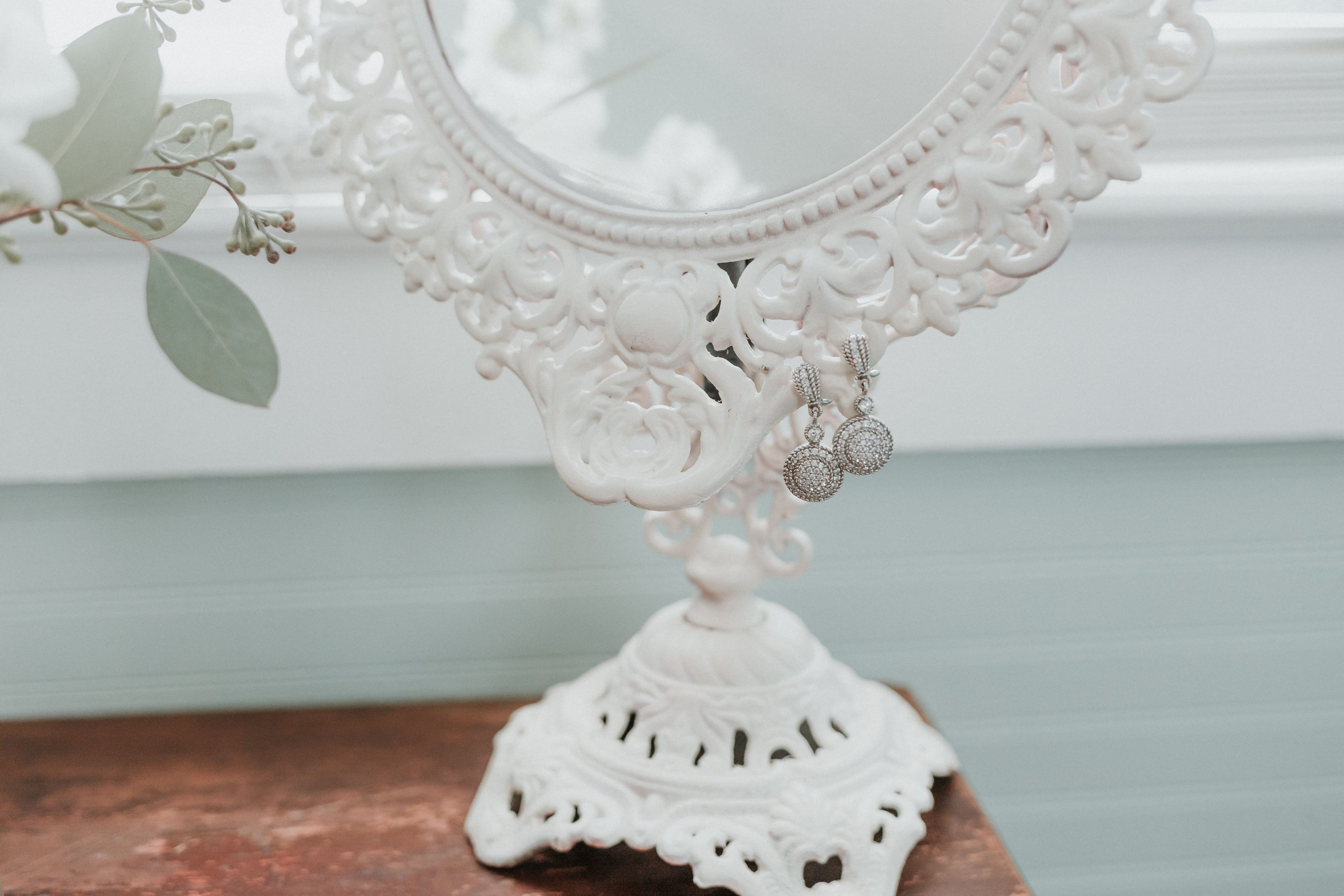 Detail shot of stunning bridal earrings captured by Shutter Owl Photography for a wedding at The Ivy Place