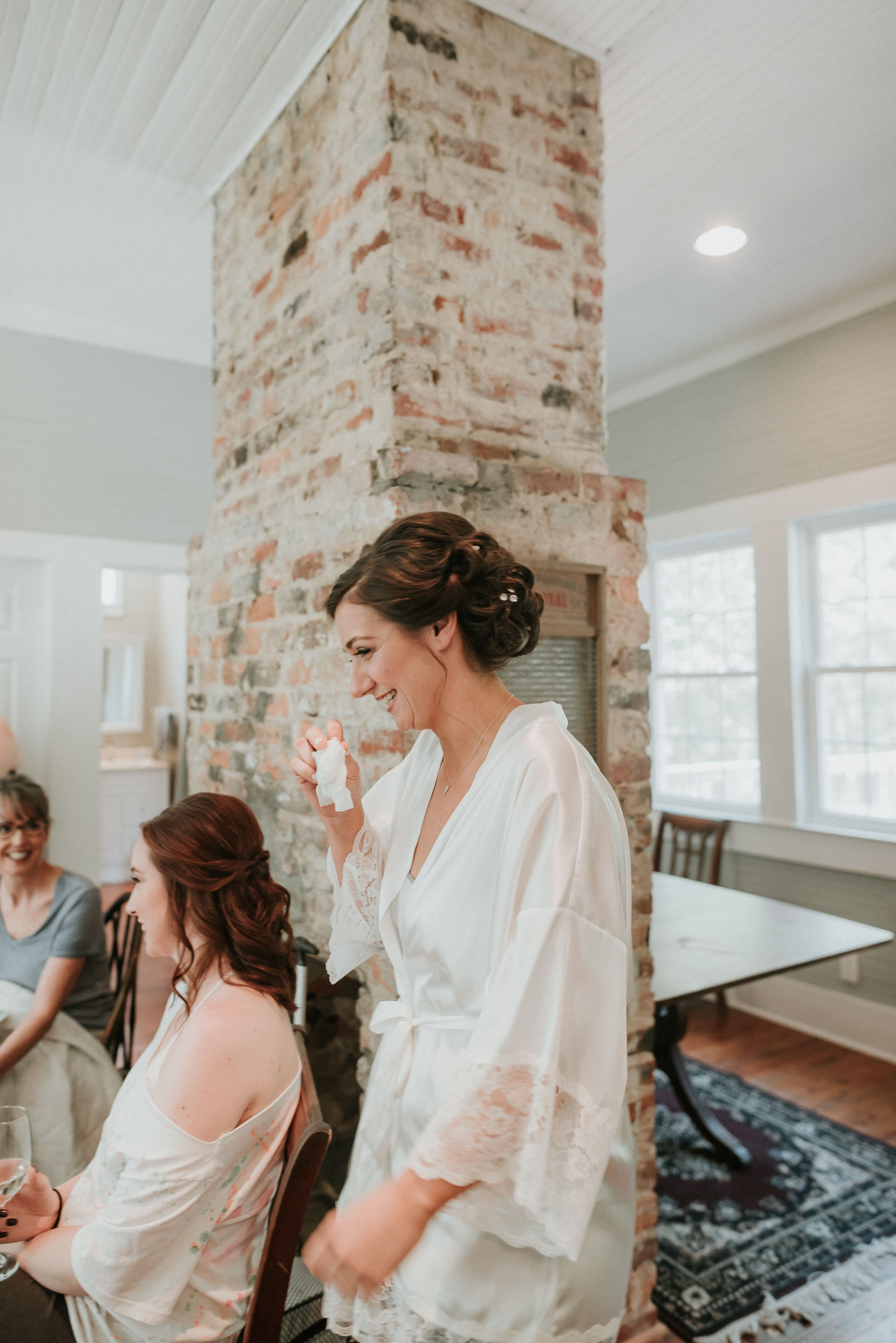 Bride and her bridesmaids share sweet moments together as Cali Stott Artistry puts the finishing touches on hair and makeup