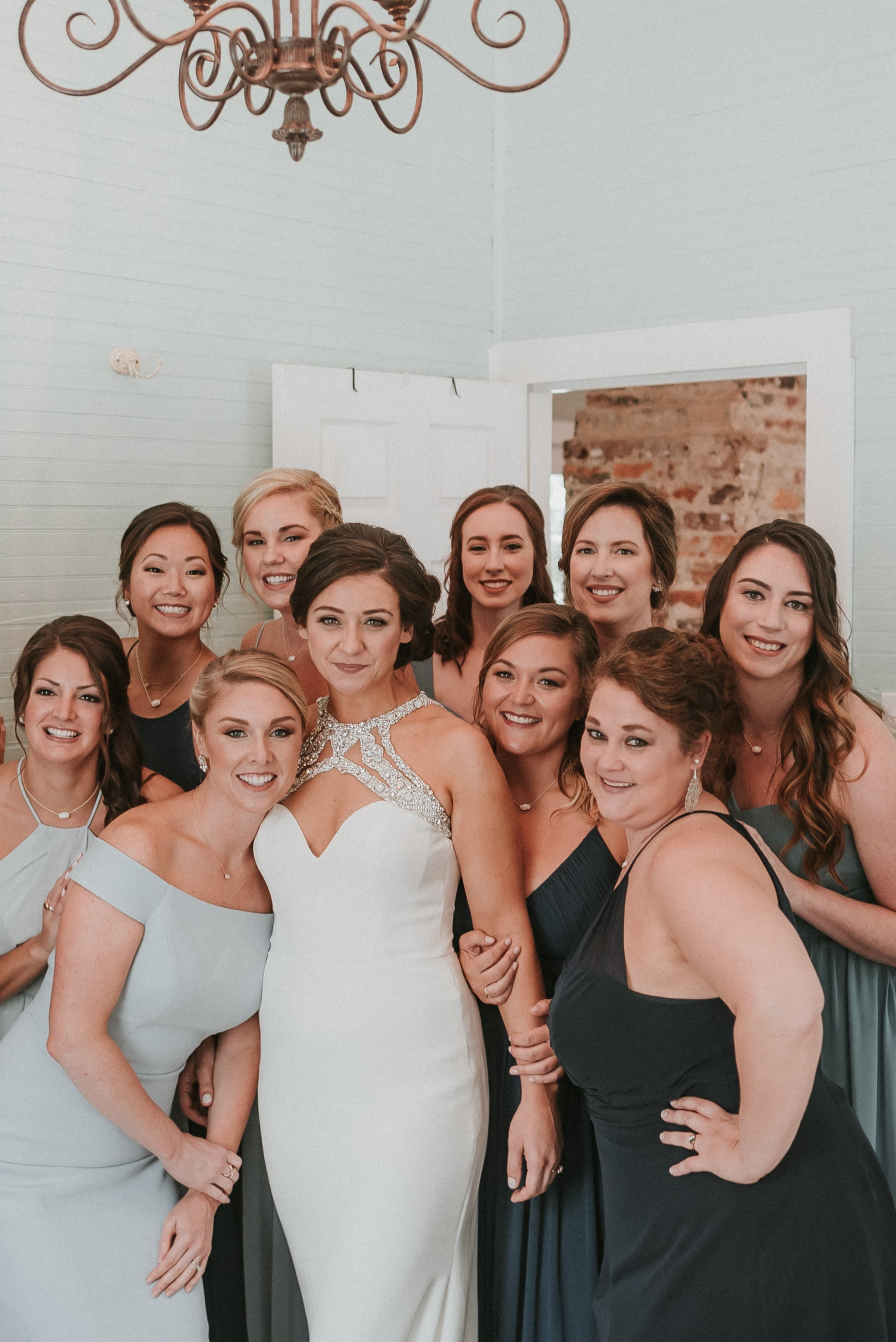 Bride poses with her bridal party at The Ivy Place for Shutter Owl Photography