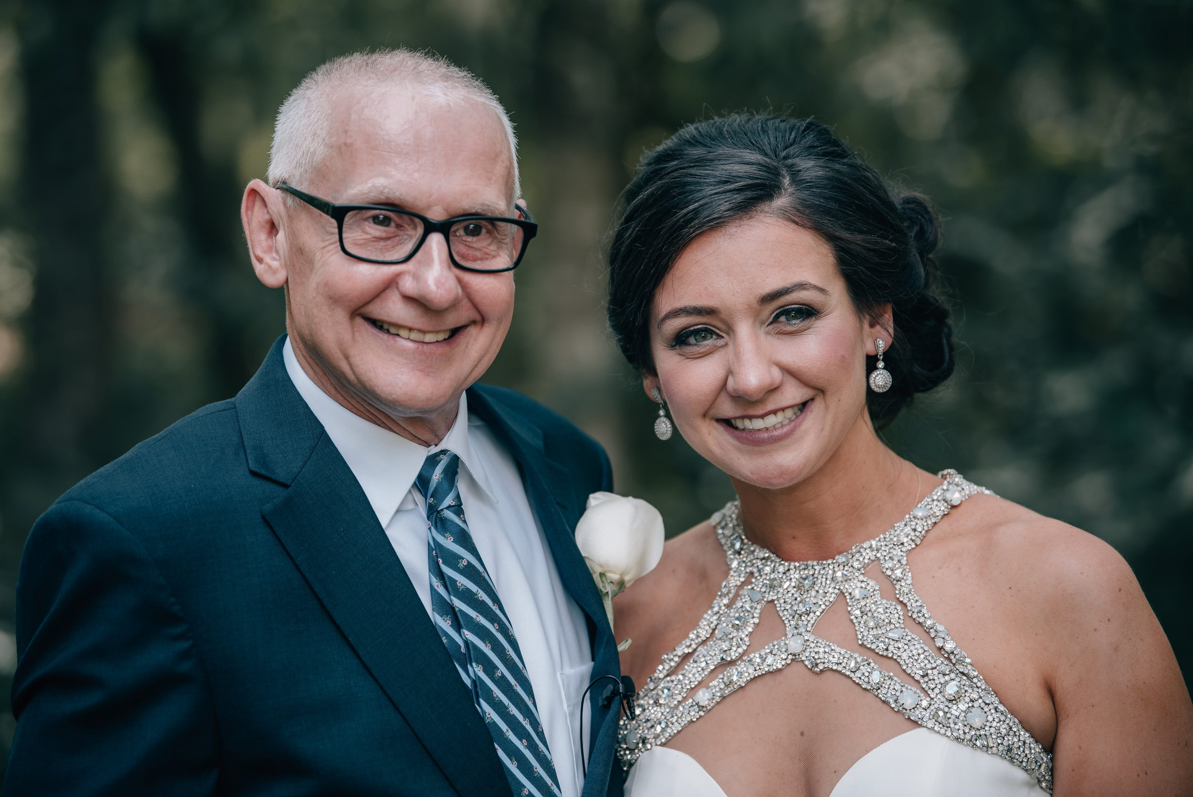 Bride poses with dad during her summer wedding at The Ivy Place designed by Magnificent Moments Weddings