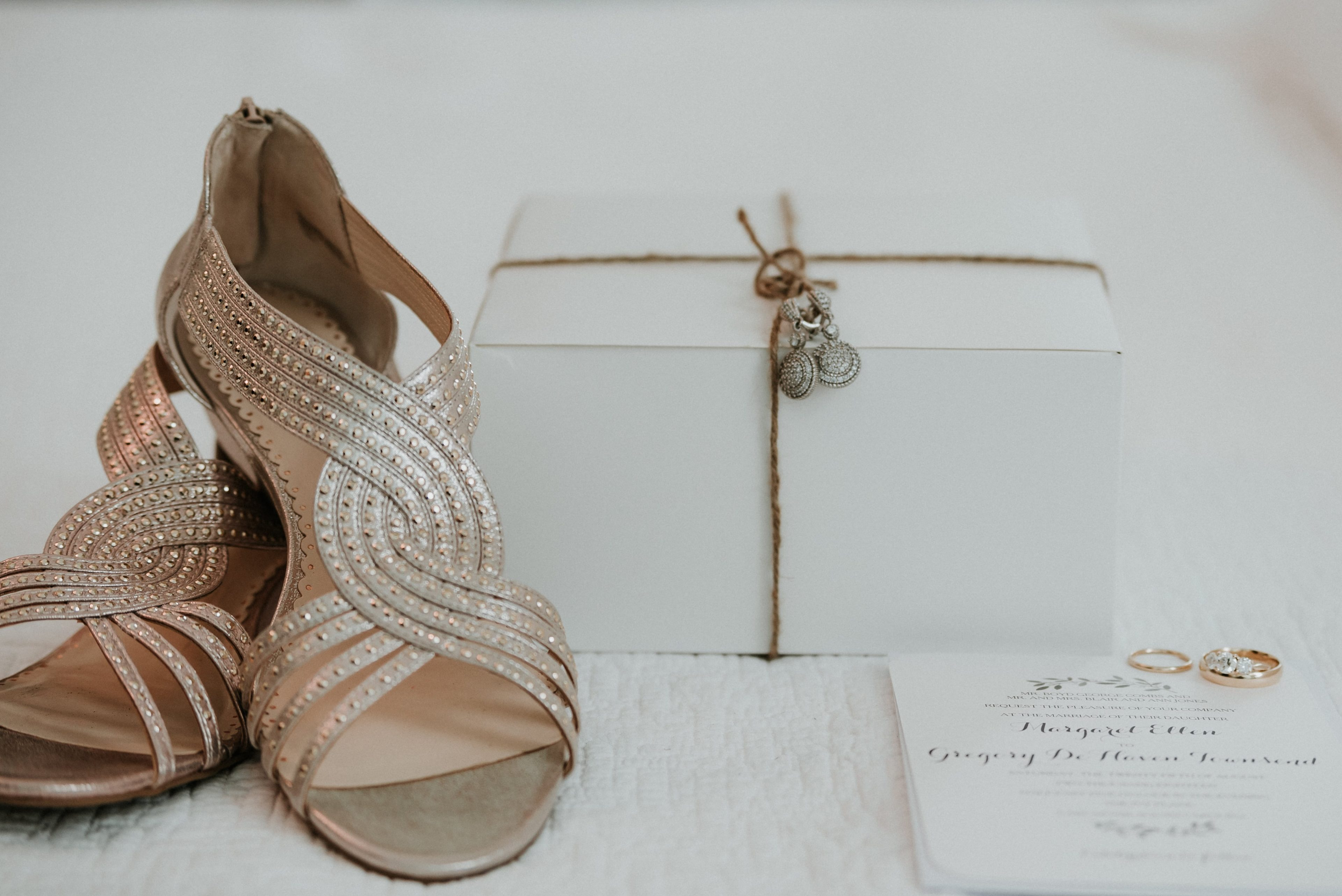Bride created a custom welcome box for her out of town guests captured here with her bridal shoes and jewelry by Shutter Owl Photography