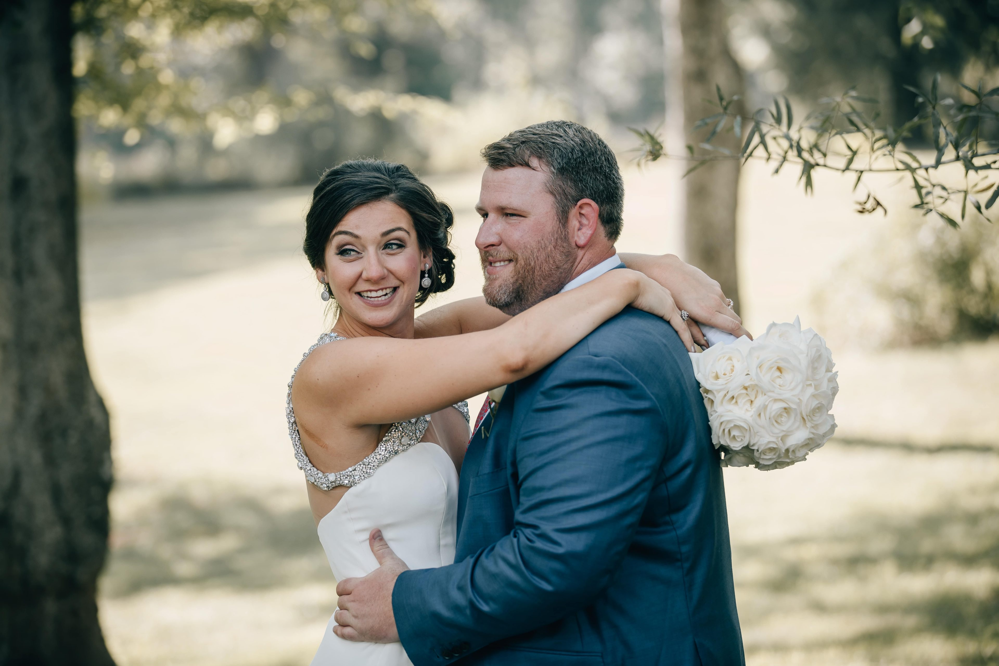 Bride and groom share a sweet moment captured by Shutter Owl Photography during their summer wedding at The Ivy Place
