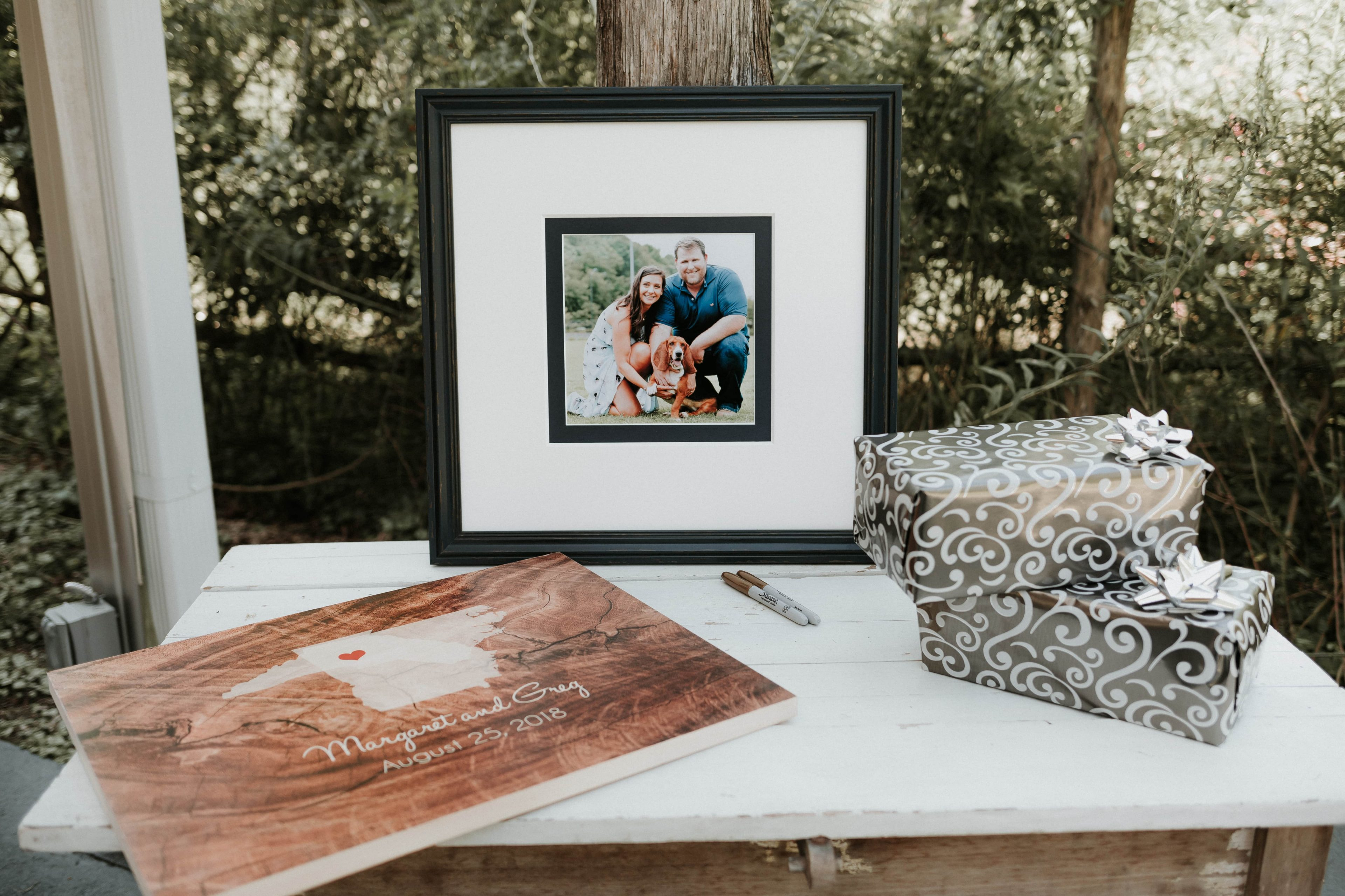 Couples guest book included a farmed photo mat and state board to be signed by guest at an Ivy Place Wedding designed by Magnificent Moments Weddings