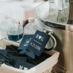Bride and groom had custom blue koozies made for their wedding complete with their monogram and wedding date