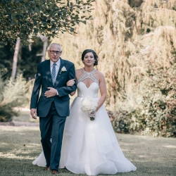 Shutter Owl Photography captures a birde being escorted down the aisle by her father to her ceremony at The Ivy Place designed and coordinated by Magnificent Moments Weddings