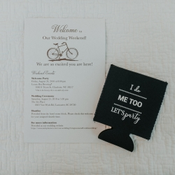 Wedding invitation shows off the couples love of bicycles and a fun party koozie is perfect for cold drinks from the bar from a wedding at The Ivy Place