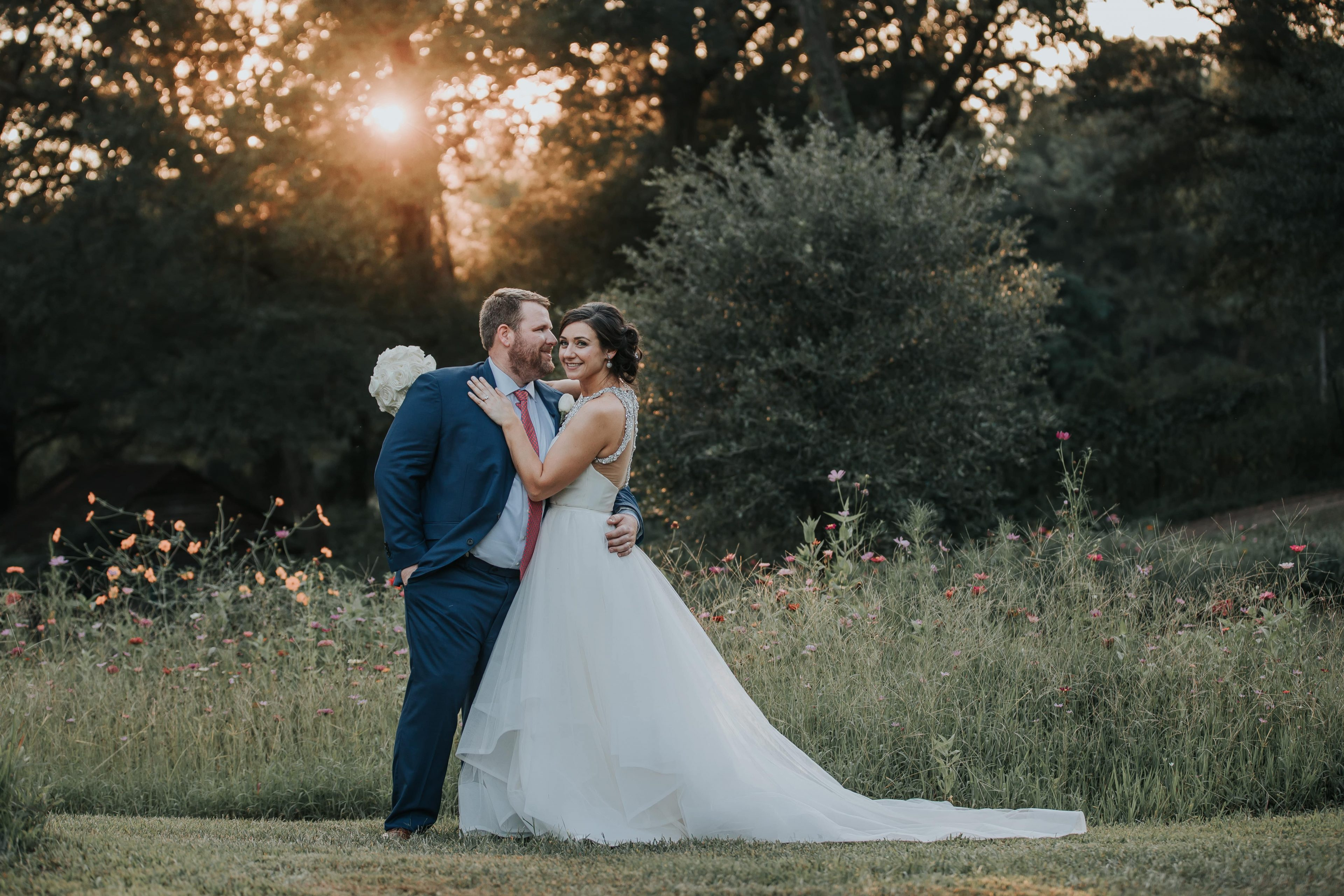 Bride and groom pose on the stunning grounds of The Ivy Place for a sweet picture captured by Shutter Owl Photography