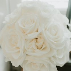 Party Blooms created a simple bridal bouquet of white roses for a summer wedding at The Ivy Place designed by Magnificent Moments Weddings