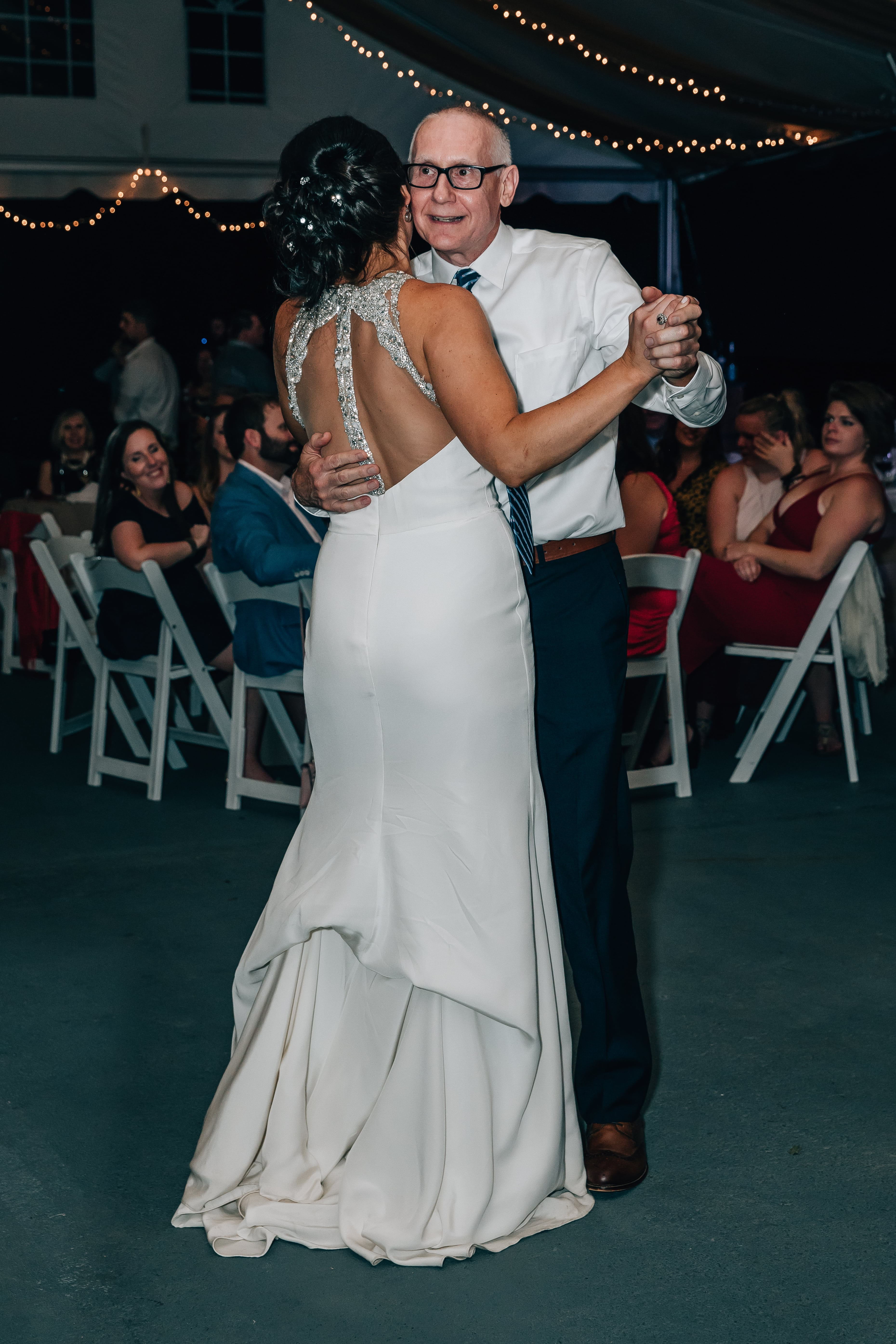 Bride dances with her father to music from Southside Station at her wedding reception designed by Magnificent Moments Weddings
