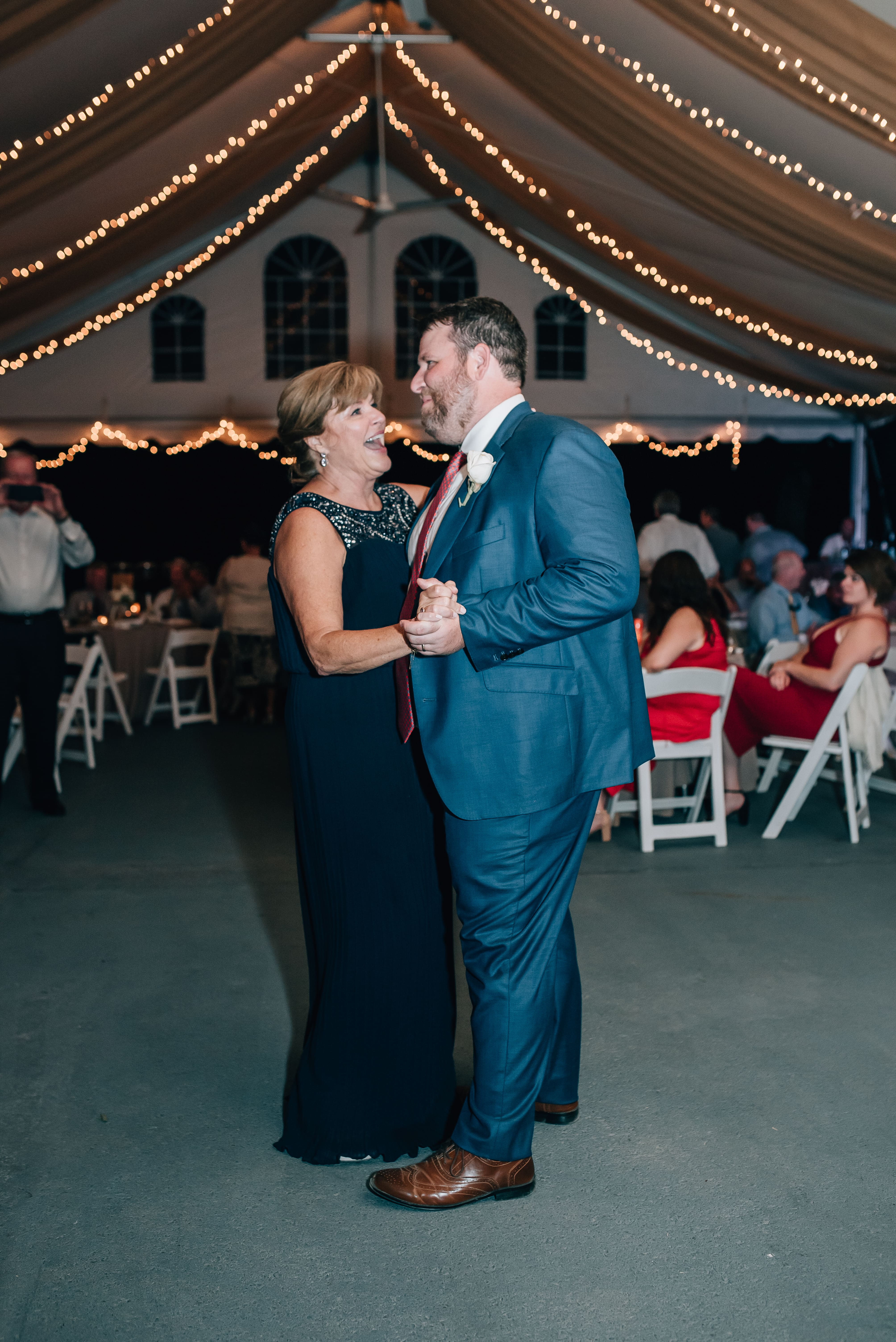 Groom dances with his mother to music by Southside Station at his wedding reception held at The Ivy Place