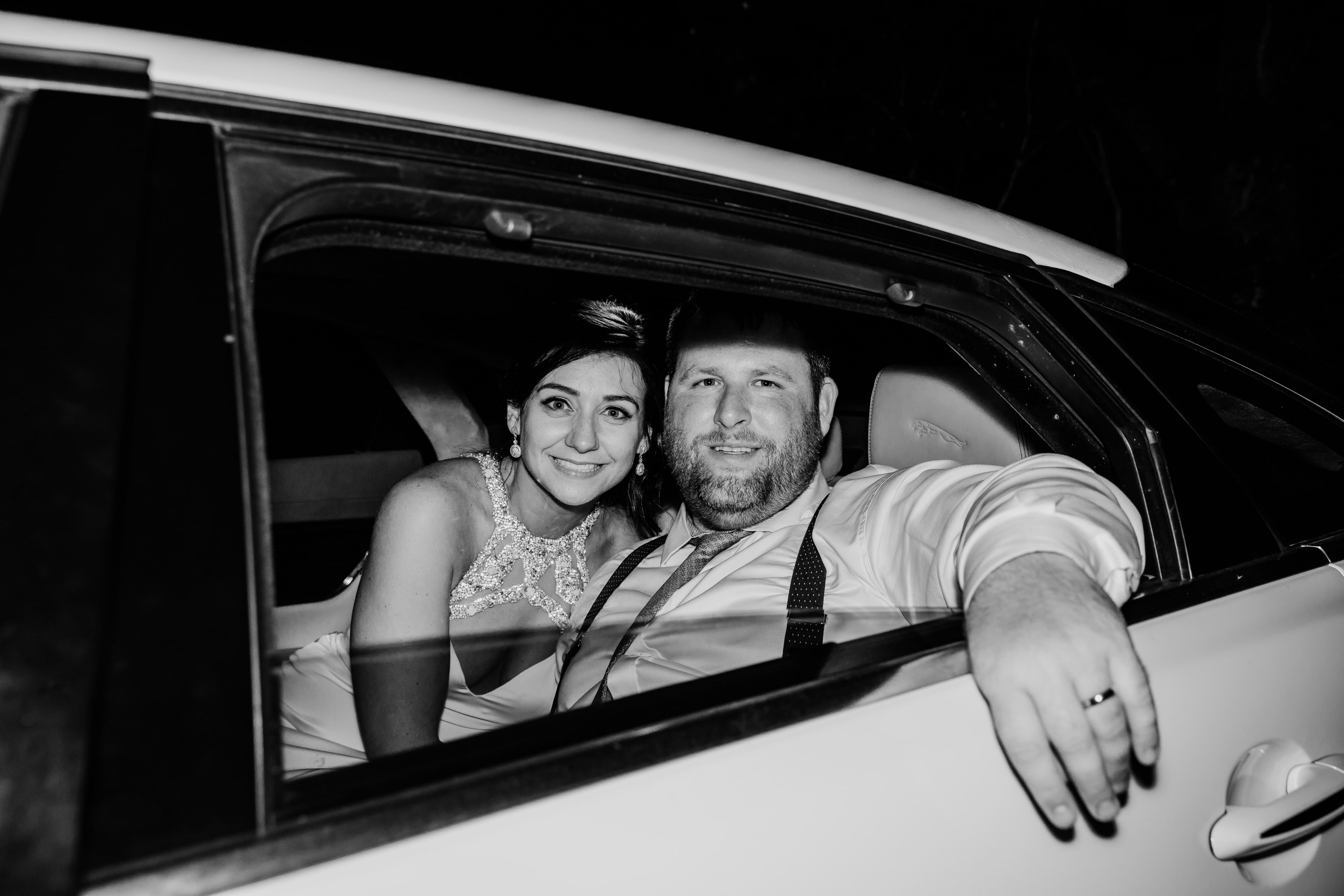 Bride and groom left the reception in a vintage car after the dancing the night away at The Ivy Place