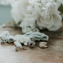 Shutter Owl Photography captures a stunning detail shot of the brides rings and garter for her wedding at The Ivy Place