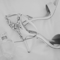 Smitten and Hooked captures detail shot of bridal shoes and perfume for a wedding in Uptown Charlotte