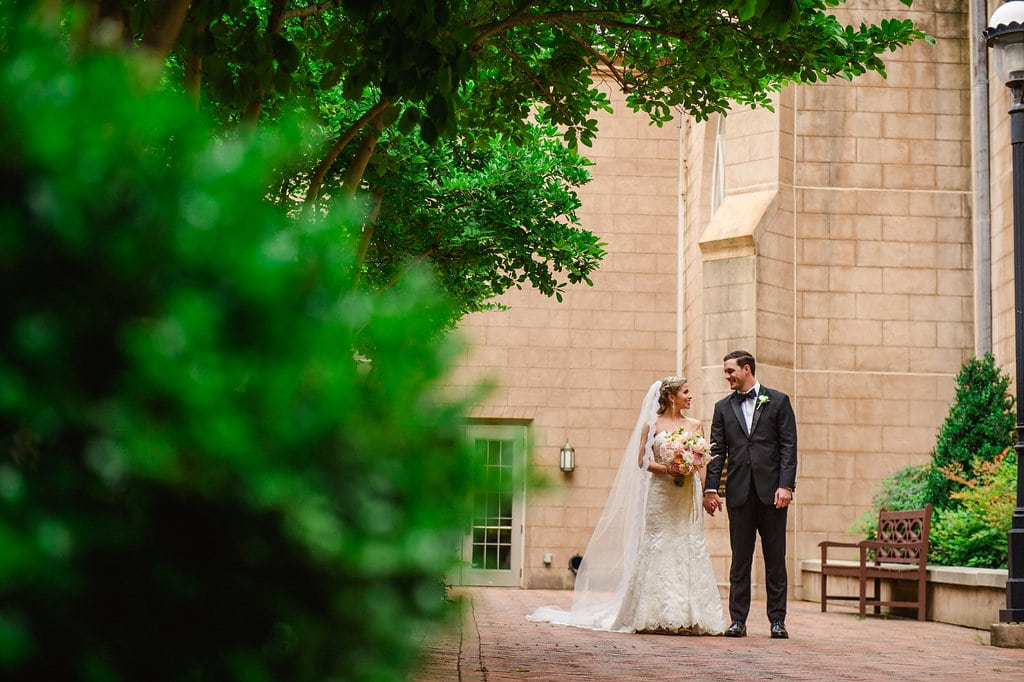 Bride and groom stroll First Presbyterian Church after their wedding reception captured by Smitten and Hooked