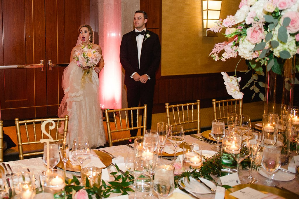 Bride's stunned reaction after seeing her reception space at The Ritz Carlton coordinated by Magnificent Moments Weddings