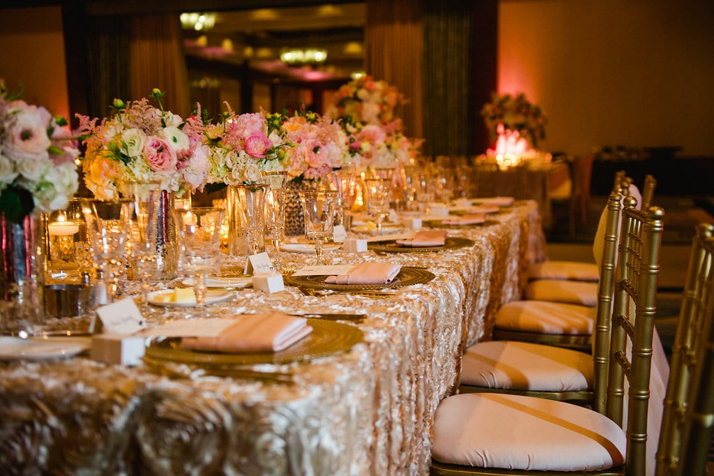 Gold chivari chairs rented from Party Reflections create a elegant feel for an Uptown Charlotte wedding reception captured by Smitten and Hooked
