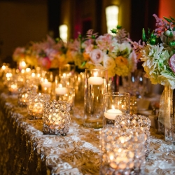 Diamond votives and lush linens from Party Reflections create an elegant look for a Ritz Carlton wedding reception coordinated by Magnificent Moments Weddings