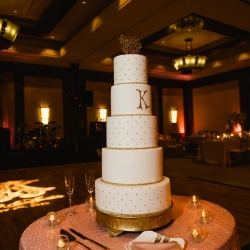 Grand five tier cake created by Bar Cocoa features the couples initial and is displayed during a stunning reception at The Ritz Carlton