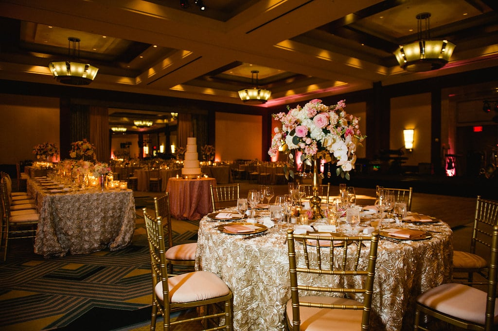 Large floral centerpieces by The Flower Diva create an elegant feel for an Uptown Charlotte wedding