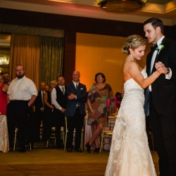 Bride and groom share a first dance during their wedding reception at The Ritz Carlton coordinated by Magnificent Moments Weddings