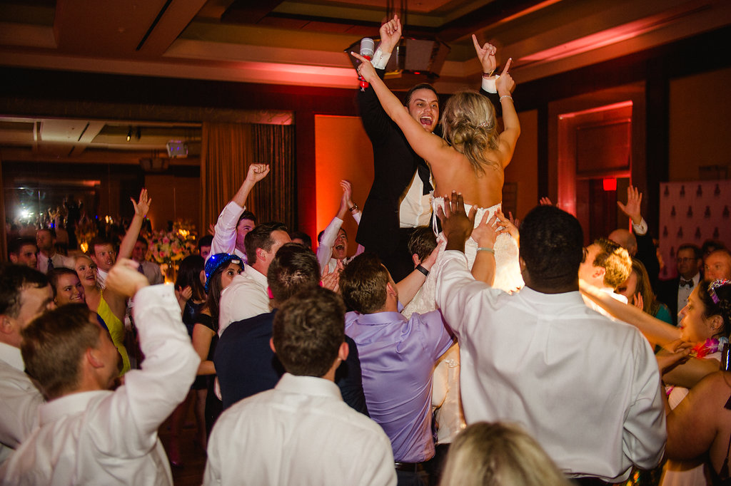 Bride and groom dance to music provided by Sol Fusion during their Ritz Carlton wedding reception coordinated by Magnificent Moments Weddings
