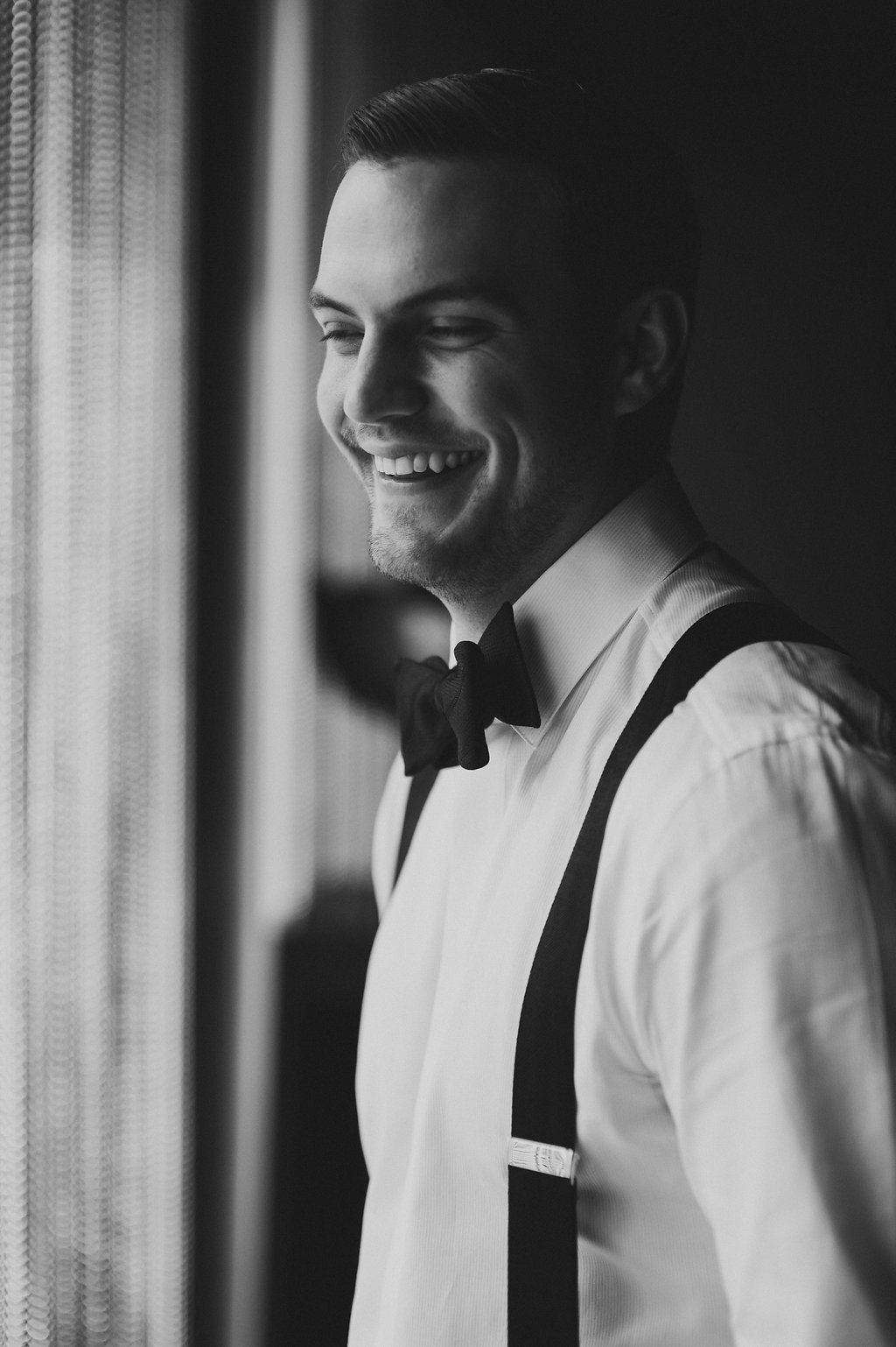 Smitten and Hooked capture a groom getting ready before his Uptown Charlotte wedding at The Ritz Carlton