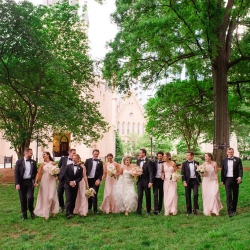 Bride and groom pose with their bridal party following their wedding ceremony at First Presbyterian Church in Uptown Charlotte