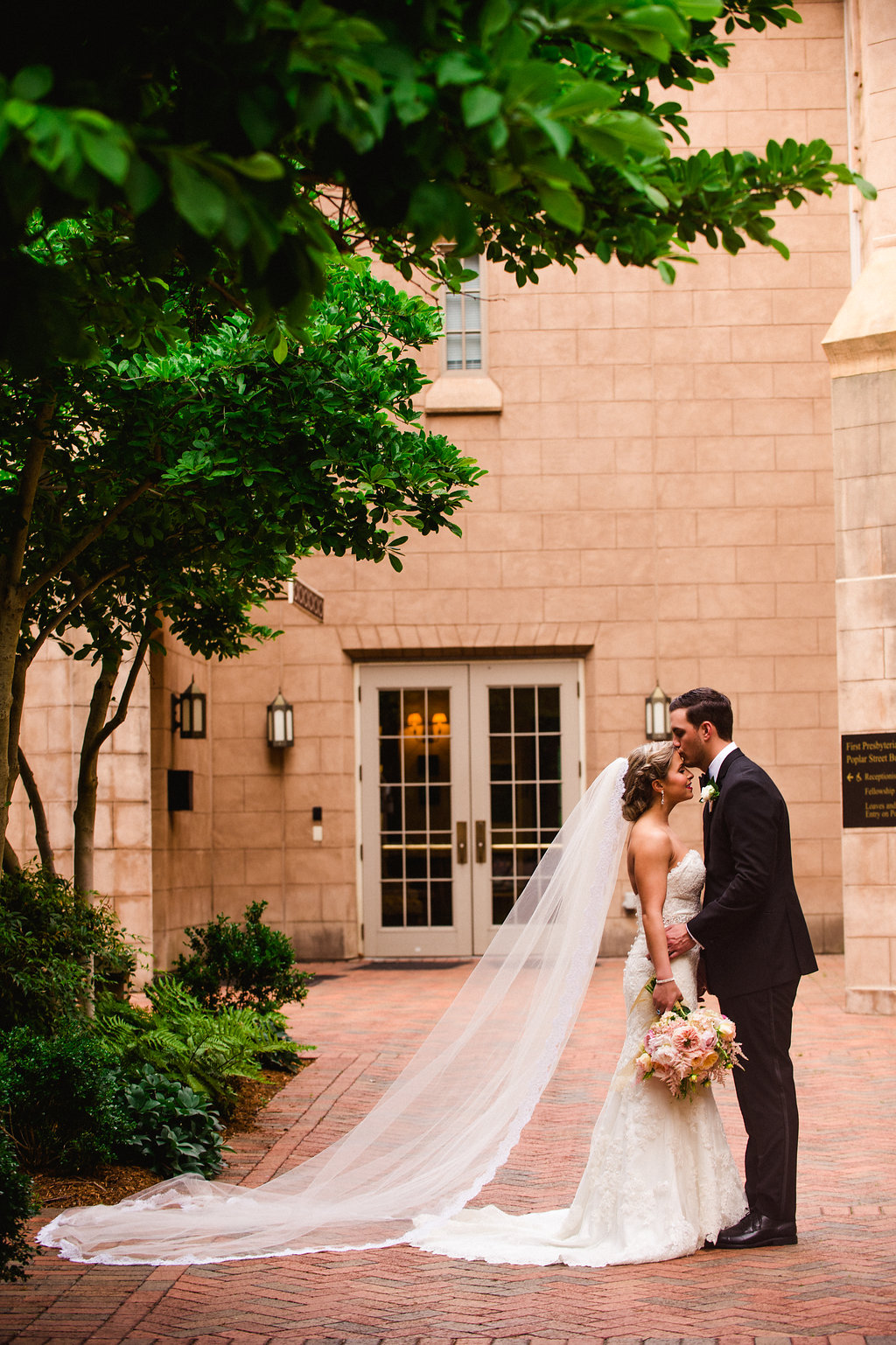 Bride and groom embrace after their wedding ceremony at First Presbyterian