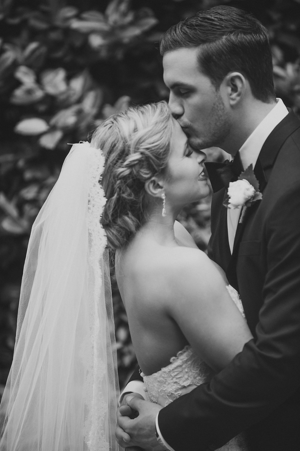 Smitten and Hooked captures a bride and groom embracing during their wedding at The Ritz Carlton in Uptown Charlotte