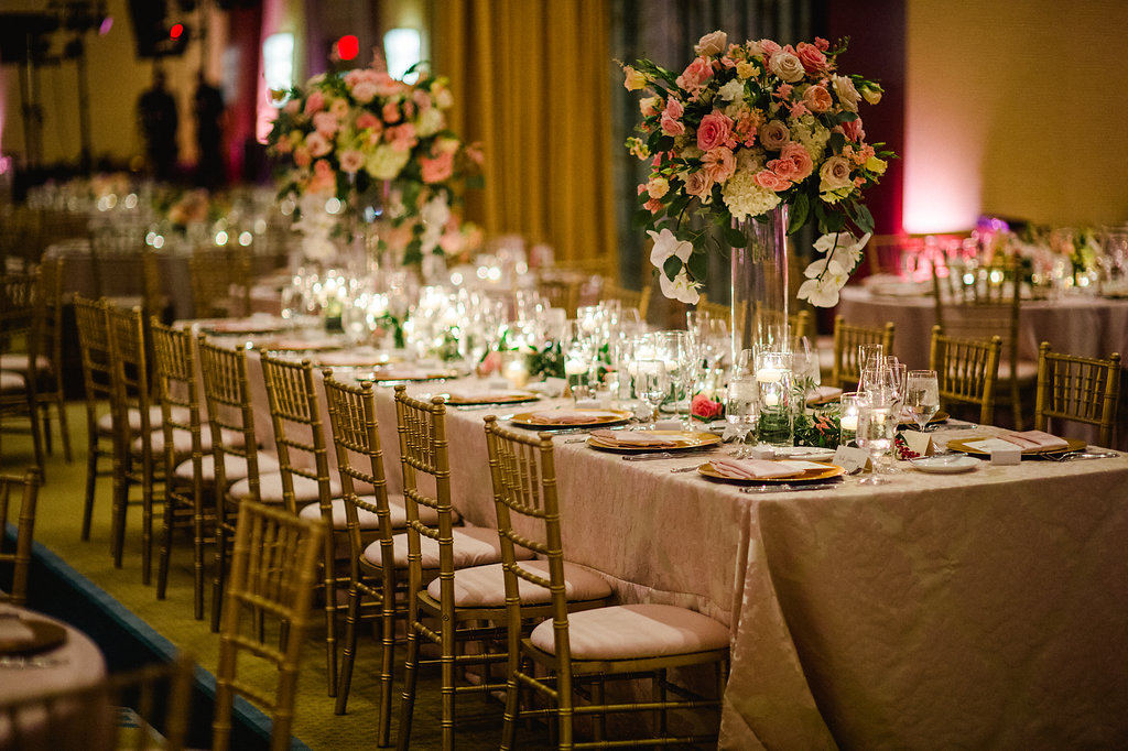 High centerpieces of roses and hydrangeas created by The Flower Diva create an elegant feel for an Uptown Charlotte wedding
