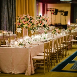 Blush pink linens and gold chivari chairs from party reflections create an elegant atmosphere for a Uptown wedding at The Ritz Carlton